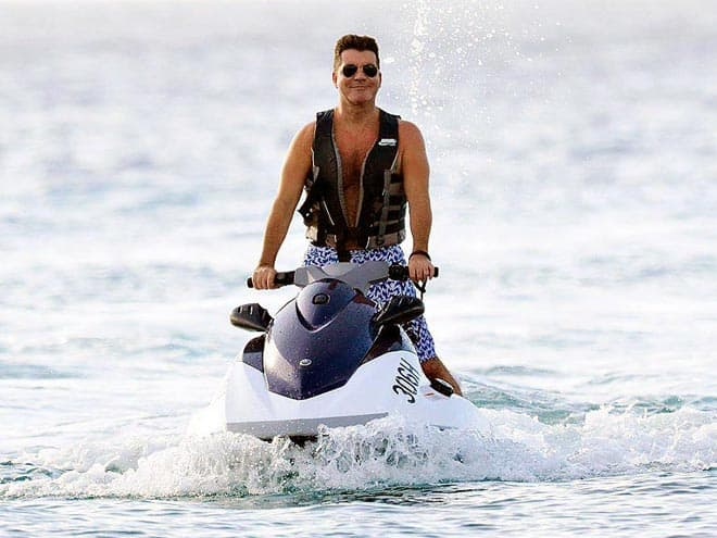 simon cowell 660 How Did Celebrities Spend Their 2013 NYE & Winter Holidays?