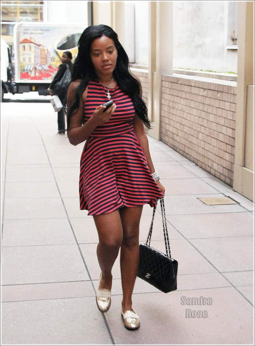 Angela Simmons walking her dog outside her hotel in New York City.
