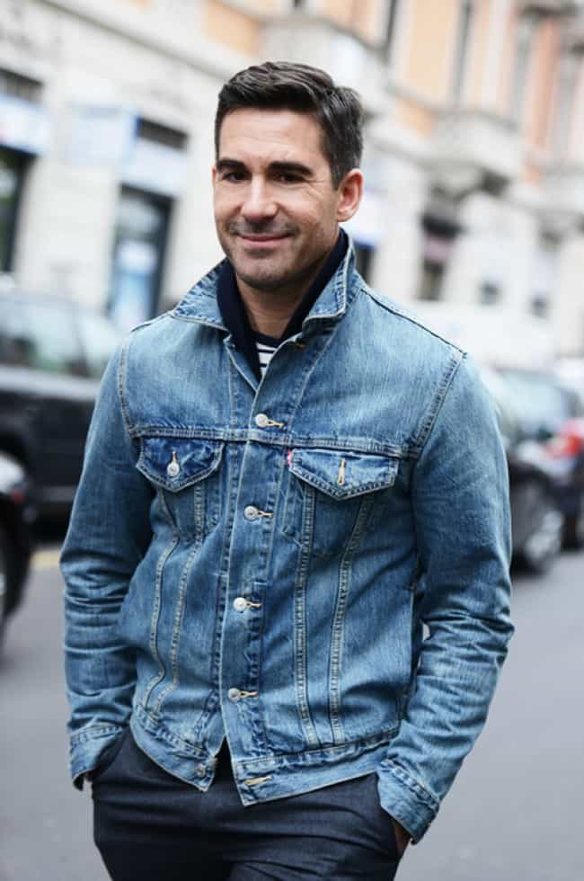 How to Wear a Denim Jacket. A denim jacket is a versatile piece that should be in every man's wardrobe, it can be worn casually every day or for slightly more formal occasions. Layering the denim jacket is a good option, this means it can be worn in more than just one season. Put a jumper underneath or a bigger coat over the top.