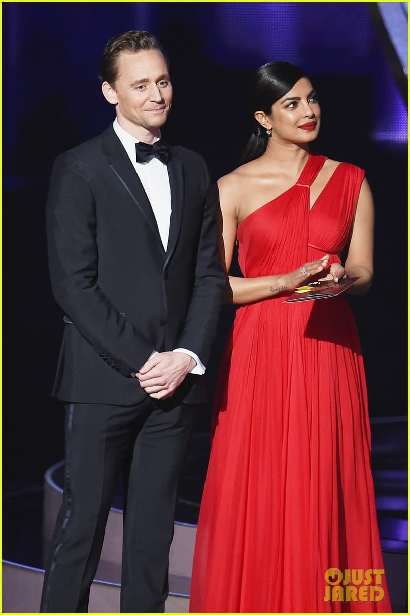 LOS ANGELES, CA - SEPTEMBER 18: Actors Tom Hiddleston and Priyanka Chopra speak onstage during the 68th Annual Primetime Emmy Awards at Microsoft Theater on September 18, 2016 in Los Angeles, California. (Photo by Kevin Winter/Getty Images)