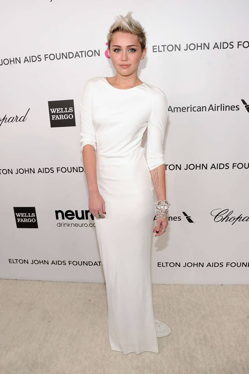 miley-cyrus-white-backless-half-sleeve-floor-length-evening-dress-oscars-2013
